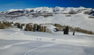 winter aerial Gunsight pass with skiers